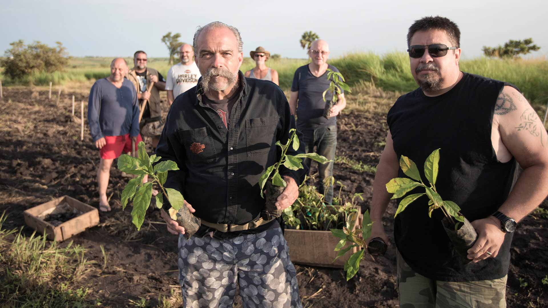 Sam Childers planting food at the farm